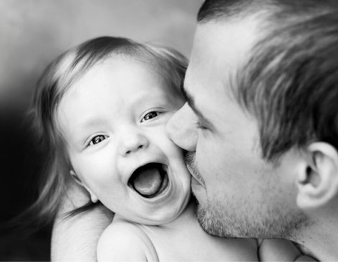father-kisses-cute-daughter