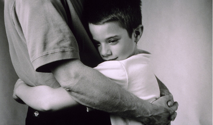 Son hugging father --- Image by © Robert Essel NYC/CORBIS