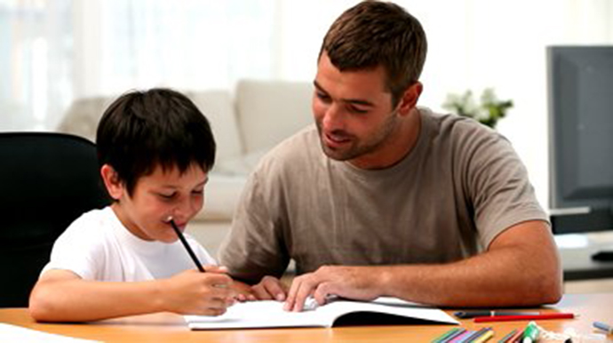stock-footage-father-and-son-doing-homework-on-the-table-in-the-living-room