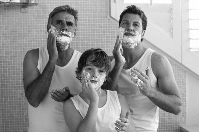 grandfather, father and son applying shaving cream