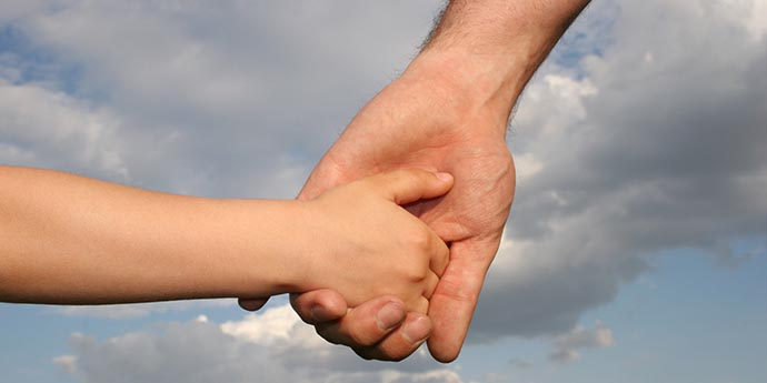 o-FATHER-HOLDING-SONS-HAND-facebook