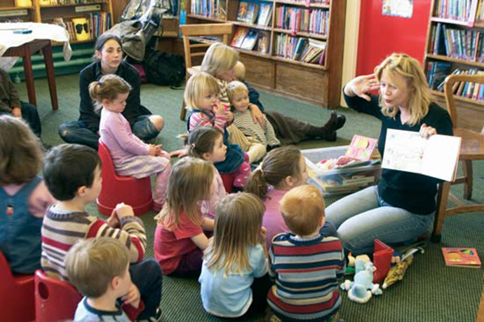 group of young children during story time at the library