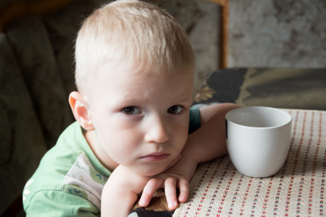Sad upset tired worried little child (boy) close up portrait