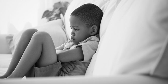 landscape-1446501525-boy-alone-couch