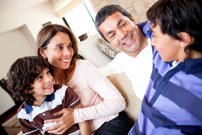 bigstock-family-talking-and-a-boy-telli-33922388