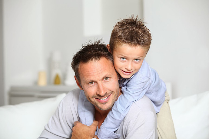 bigstock-Closeup-of-father-and-son-at-h-169929651