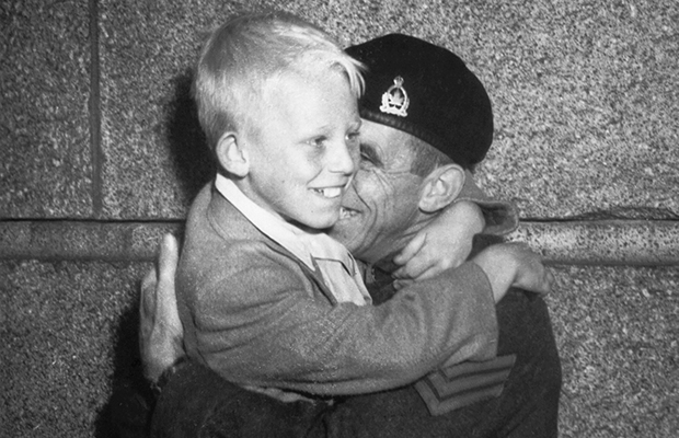 "Correct Spelling: Claude Dettloff Added info: Warren Bernard (boy) in the arms of his father Jack Bernard when he returned from WW2 - they were first photographed Oct. 1, 1940 in the famous Claud Detloff photo ""Wait For Me Daddy"" FOR DAVID SPANER UNWIND STORY - Warren Bernard, the child in the famous Province photo shown waving goodbye to his dad as he marches off to war, is seen here being reunited with his father at the end of the war. Claud Detloff/The Province [PNG Merlin Archive]"